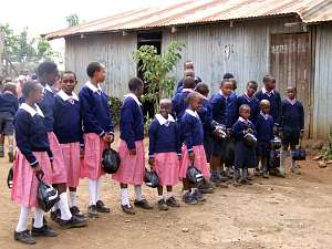A group of school children in their new school uniforms