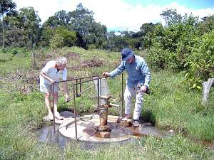 Two Rotary members test the funtioning of the water well at Kyamukoona