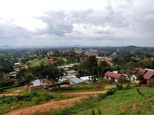Mubende district sitting amongst green fiels and trees, with hills in the background