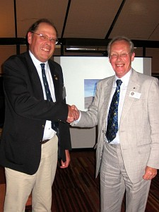 District Governor Elect Niall Blair (right) congratulates Andrew Bartholomew on receiving his Paul Harris Sapphire