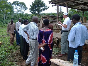 Rotarian Andrew Bartholomew talking to a group of villagers in Mubende