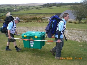 Two members of the Abingdon Vesper team carrying a ShelterBox