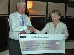 Rotarian Diane Clarke presents a cheque for £2000 to Carl Undery of the Thames Valley and Chiltern Air Ambulance Trust
