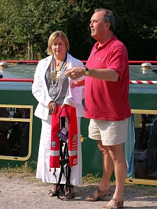 President Sulwen Vaughan presents life jackets to David Bruce